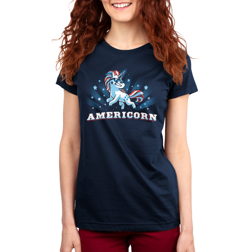 Americorn women's t-shirt model Blue t-shirt featuring a unicorn decked out in red white and blue and wearing sunglasses with shirt text