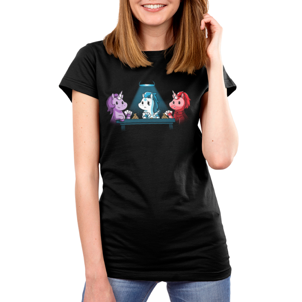 Game Night women's t-shirt model TeeTurtle black t-shirt featuring three different colored unicorns playing a game of cards with chips stacked up for two of them and only one chip for the unicorn in the middle
