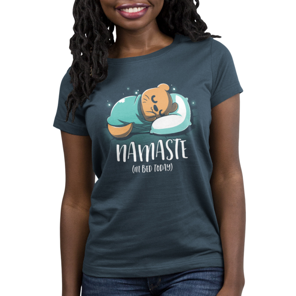 Namaste (In Bed Today) women's t-shirt model TeeTurtle indigo t-shirt featuring an otter curled up in a blanket sleeping with shirt text