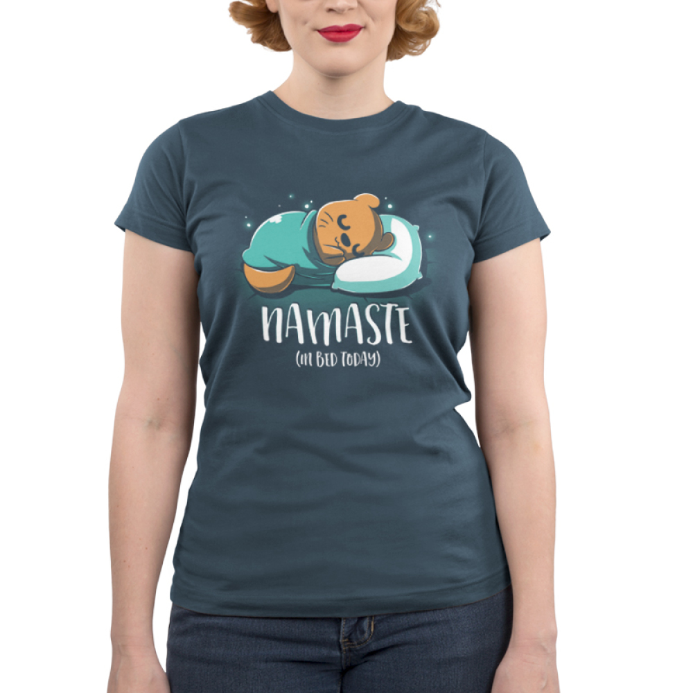 Namaste (In Bed Today) juniors t-shirt model TeeTurtle indigo t-shirt featuring an otter curled up in a blanket sleeping with shirt text
