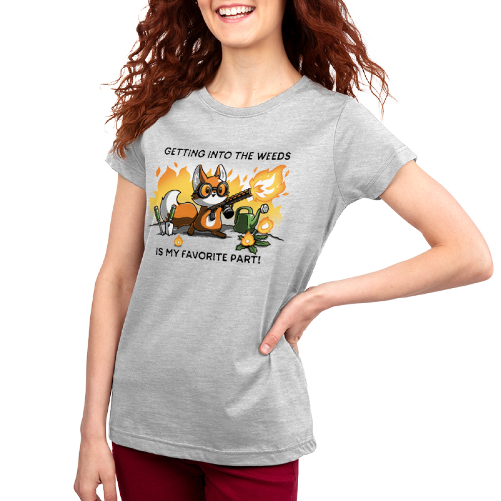 Getting into the Weeds women's T-shirt model TeeTurtle gray t-shirt featuring a fox holding a flame throw with gardening tools and plants around him and shirt text