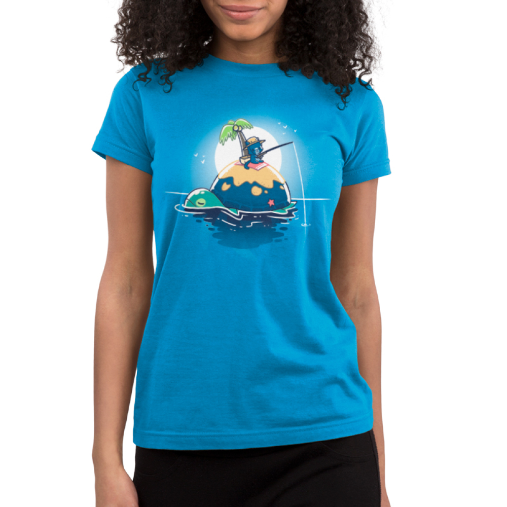 Gone Fishing juniors T-shirt model TeeTurtle blue t-shirt featuring a cat fishing on the back of a turtle who also happens to be an island