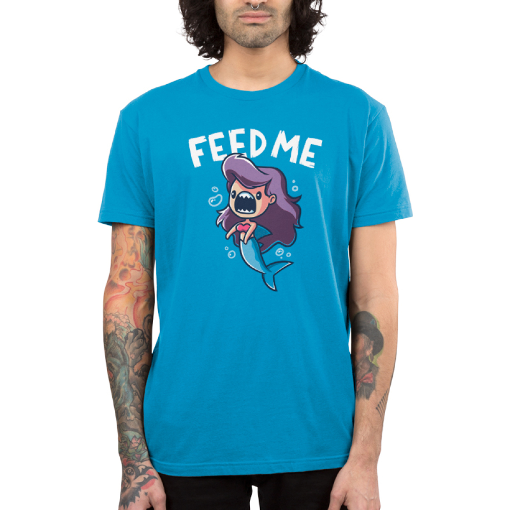 Feed Me! (Mermaid Shark) men's T-shirt model TeeTurtle blue t-shirt featuring a mermaid with shark teeth with shirt text