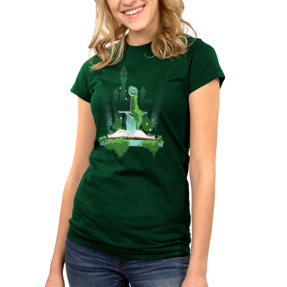 Pen and Sword junior's T-shirt TeeTurtle model green t-shirt featuring a sword sticking into a book with a castle in the background