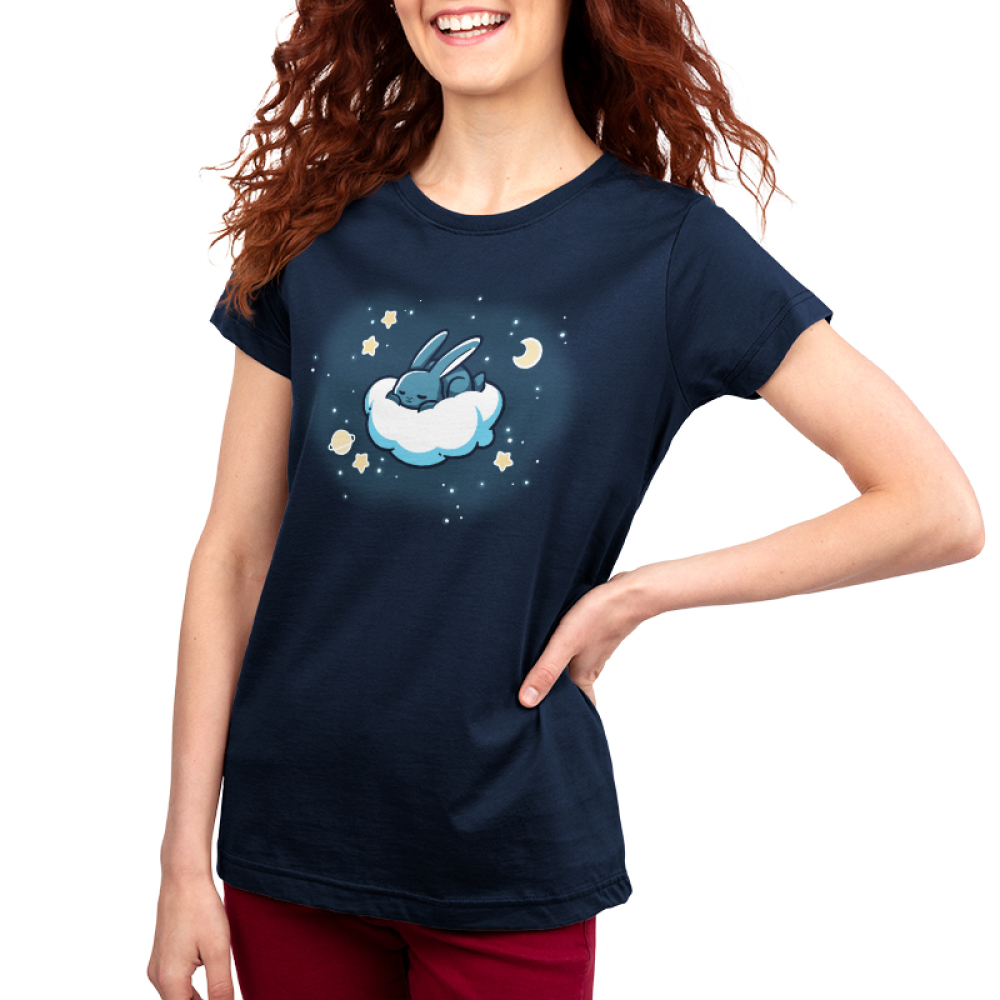 Cloud Hopper women's t-shirt model TeeTurtle navy t-shirt featuring a gray bunny sleeping on a cloud with a moon, a planet, and stars all around it