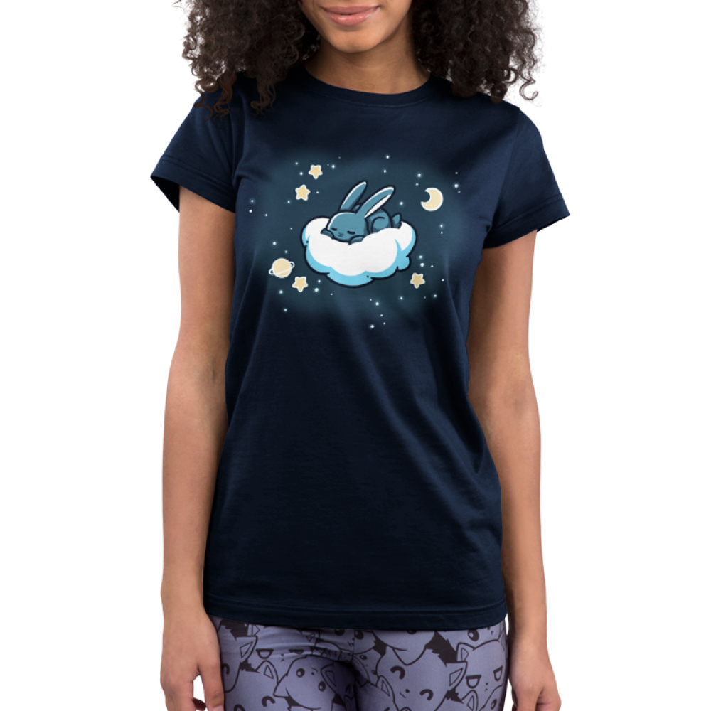 Cloud Hopper Juniors t-shirt model TeeTurtle navy t-shirt featuring a gray bunny sleeping on a cloud with a moon, a planet, and stars all around it