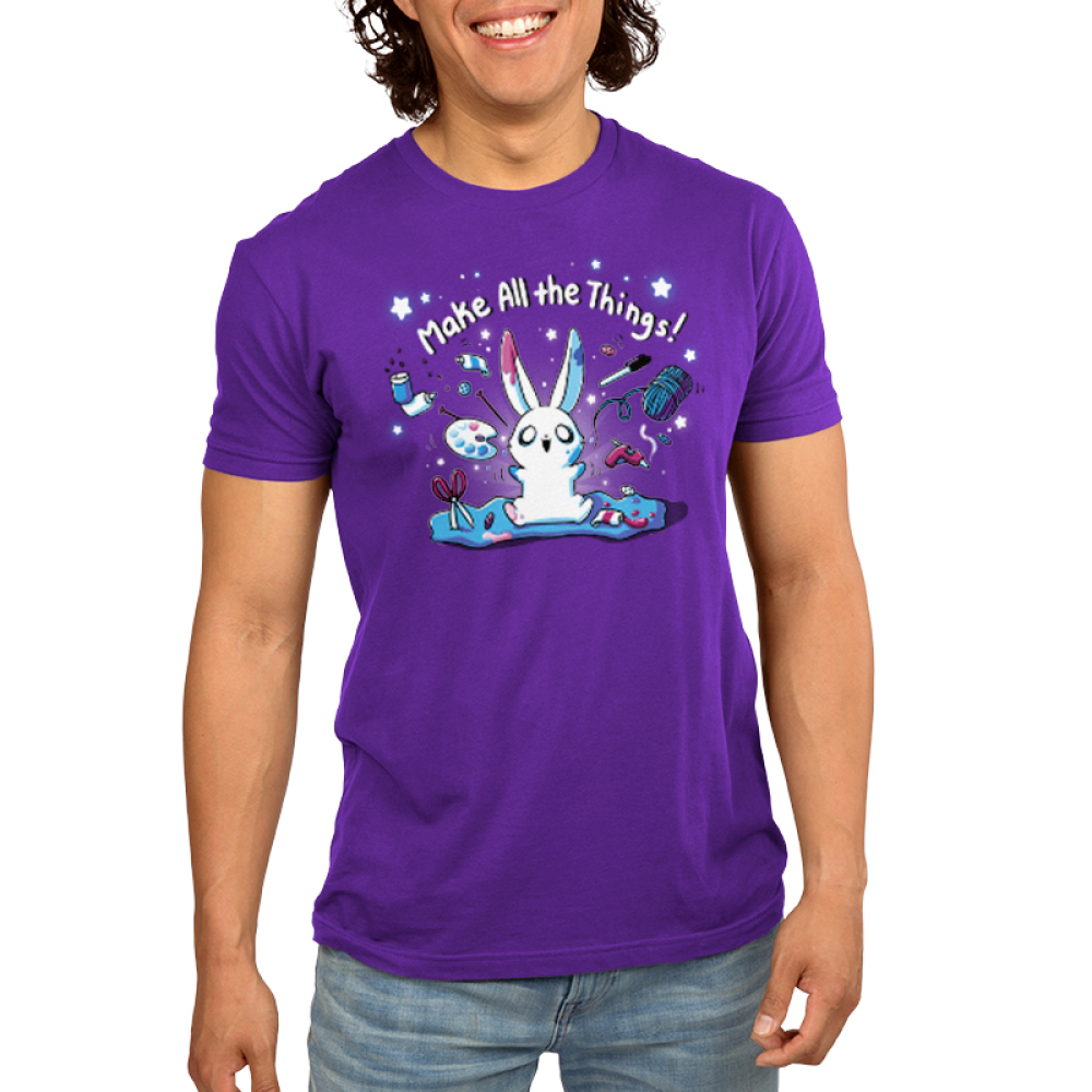 Make All the Things! Men's t-shirt model TeeTurtle purple t-shirt featuring a crafty white bunny surrounded by yarn, paint, scissors, glue, markers, and stars