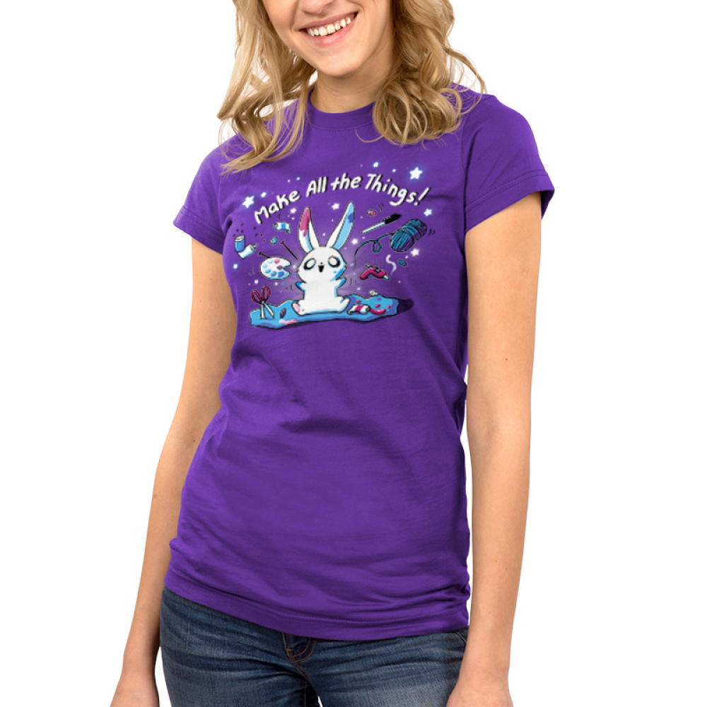 Make All the Things! Women's t-shirt model TeeTurtle purple t-shirt featuring a crafty white bunny surrounded by yarn, paint, scissors, glue, markers, and stars