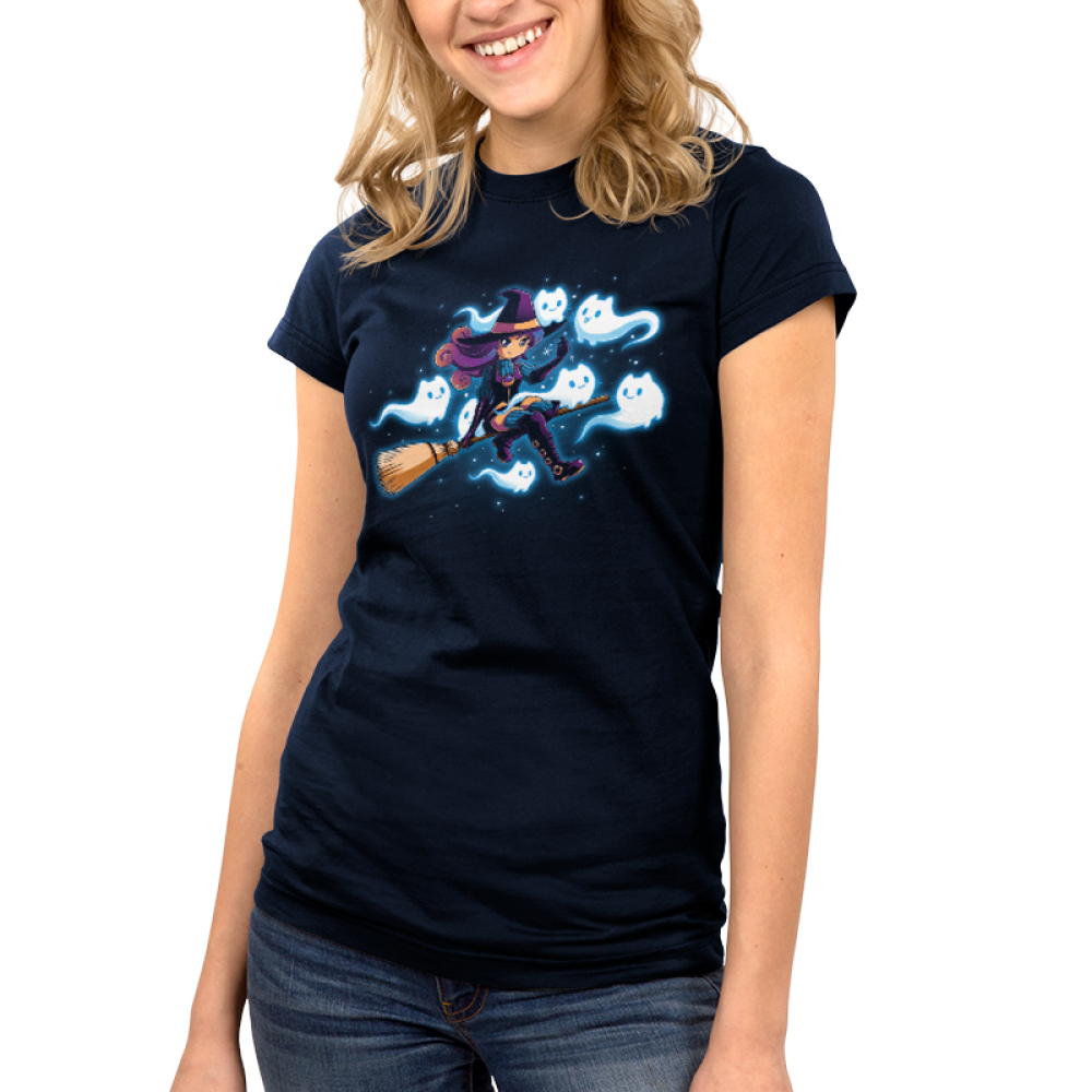 Ghostly Friends Junior's t-shirt model TeeTurtle navy t-shirt featuring a witch flying on a broom with her seven ghost friends