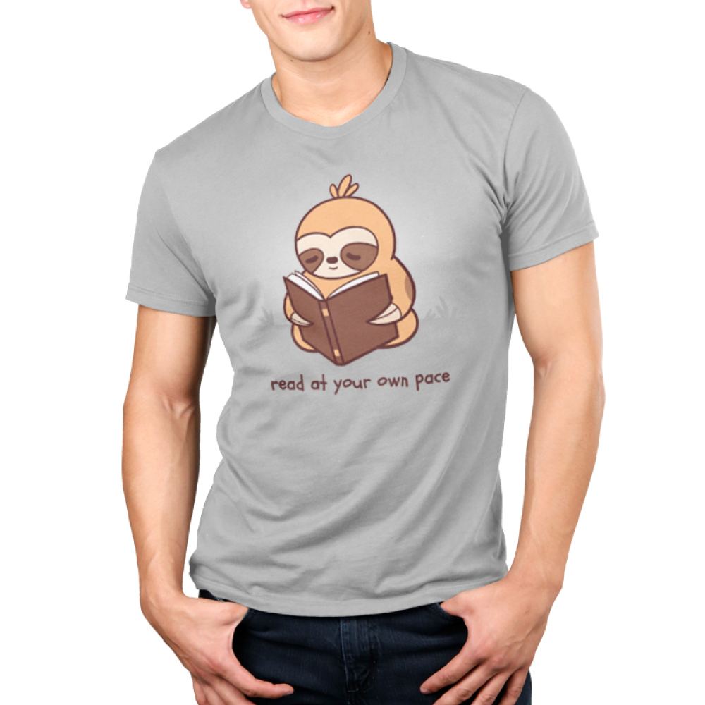 Read at Your Own pace Men's t-shirt model TeeTurtle gray t-shirt featuring a sloth reading a book in the grass