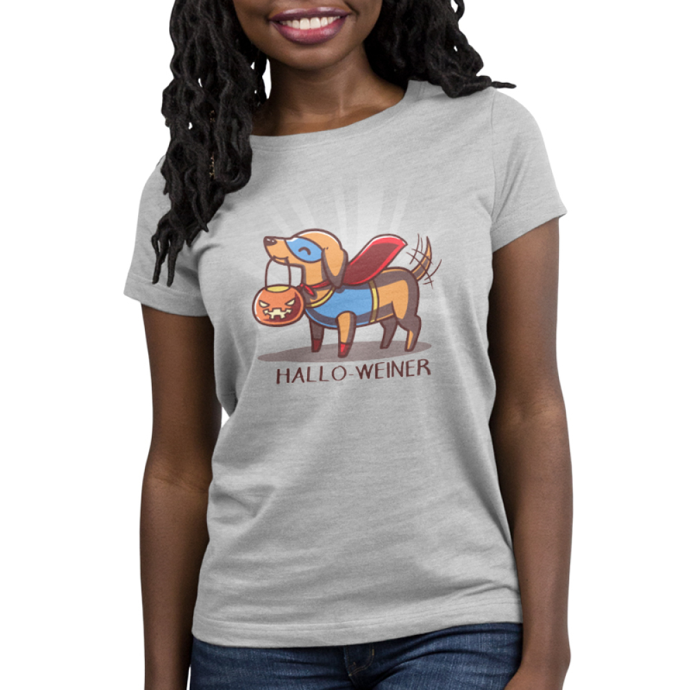 Hallo-Weinter Women's t-shirt model TeeTurtle gray t-shirt featuring a dog dressed in a super hero costume with a pumpkin candy basket in his mouth