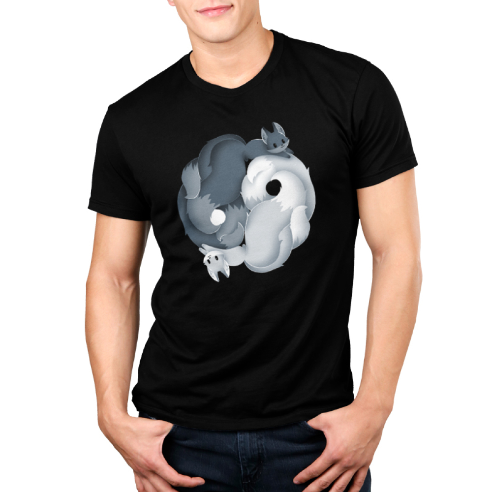 Yin Yang Kitsune Men's t-shirt model TeeTurtle black t-shirt featuring a dark grey fox and a flight gray fox intertwined to create a yin and yang sign