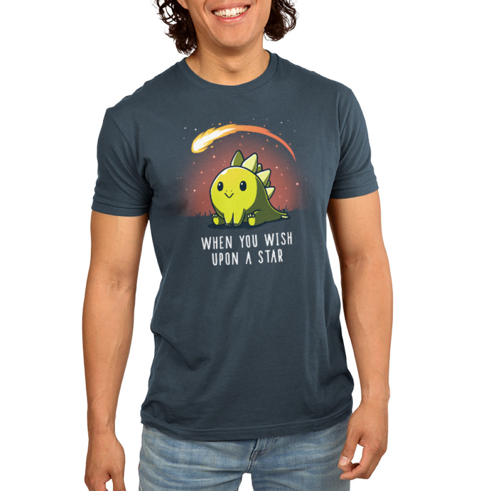 When You Wish Upon a Star Men's t-shirt model TeeTurtle indigo t-shirt featuring a dinosaur sitting in the grass with a meteor flying by