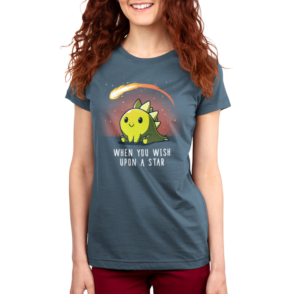 When You Wish Upon a Star Women's t-shirt model TeeTurtle indigo t-shirt featuring a dinosaur sitting in the grass with a meteor flying by