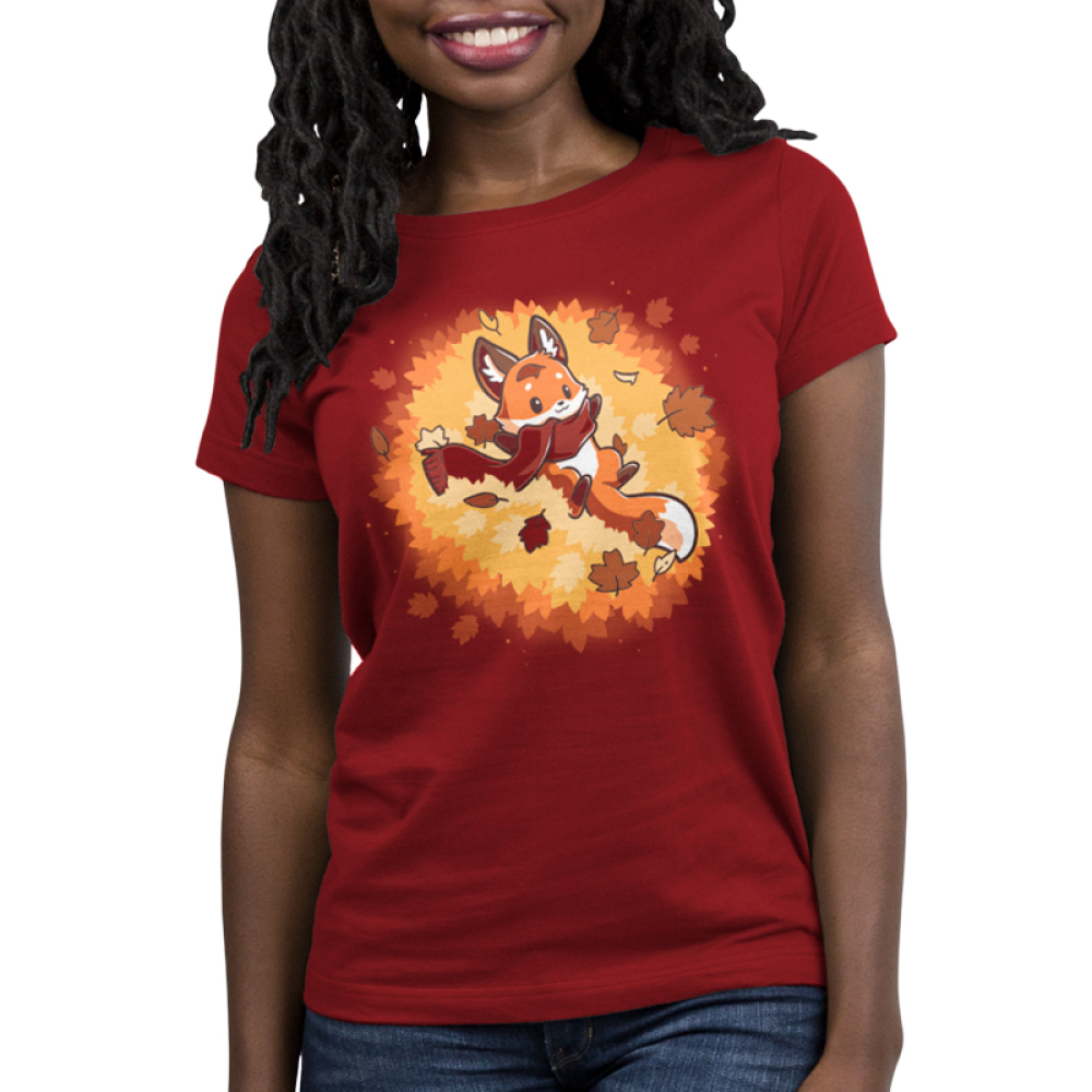 Autumn Fox Women's t-shirt model TeeTurtle red t-shirt featuring a fox with a scarf on in a pile of leaves