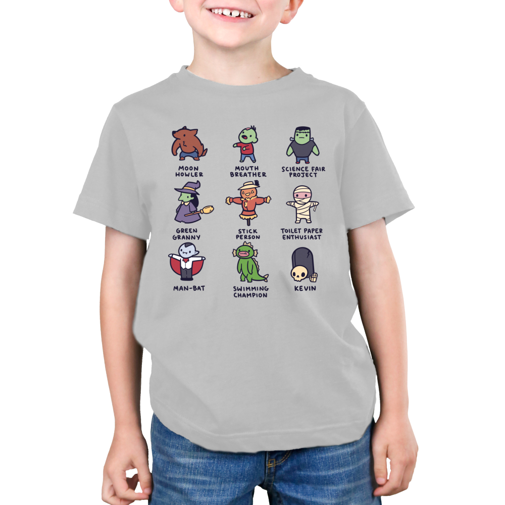 Spooky Monsters Kid's t-shirt model TeeTurtle gray t-shirt featuring a werewolf, a zombie, frankenstein, a witch, a scarecrow, a skeleton, a campire, a swamp creature, and a skeleton