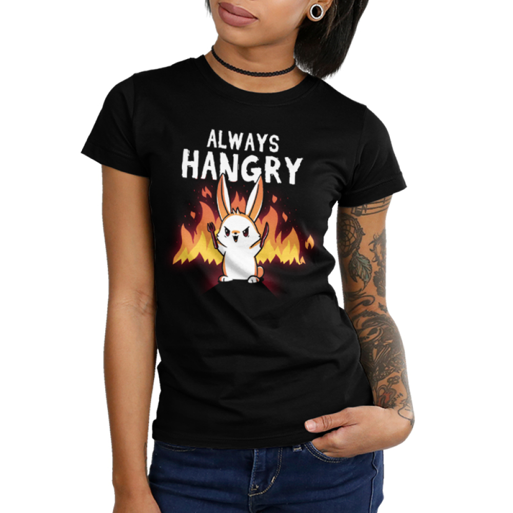 Always Hangry Bunny Junior's t-shirt model TeeTurtle black t-shirt featuring an angry bunny holding a knife and fork with fire in the background