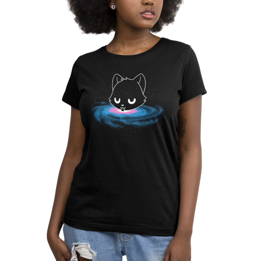 Milky Way Women's t-shirt model TeeTurtle black t-shirt featuring a cat head in outer space surrounded by stars licking from the Milky Way