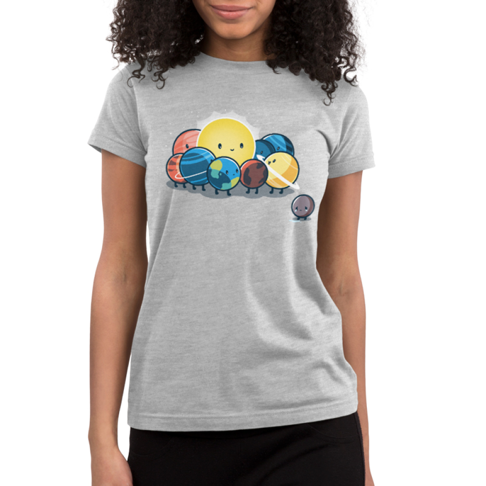 Dwarf Planet Junior's t-shirt model TeeTurtle silver t-shirt featuring a sad Pluto next to the smiling sun, Earth, Mercury, Venus, Mars, Jupiter, Saturn, Uranus, and Neptune