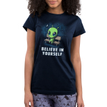 Believe in Yourself! Junior's t-shirt model TeeTurtle navy t-shirt featuring an alien sitting on a bench surrounded by stars and the moon