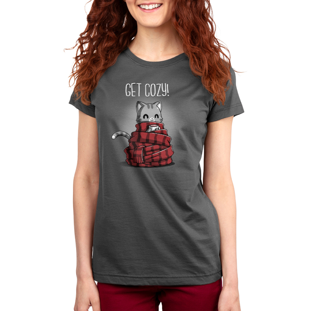 Get Cozy Women's t-shirt model TeeTurtle charcoal t-shirt featuring a cat wrapped up in a big scarf with a cup of hot chocolate