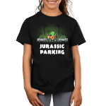 Jurassic Parking Kid's t-shirt model TeeTurtle black t-shirt featuring a dinosaur in a car in the jungle parked between two cars