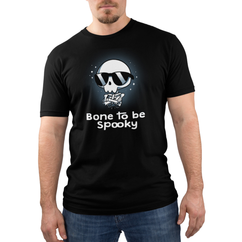 Bone to be Spooky Men's t-shirt model TeeTurtle black t-shirt featuring a skeleton in a pair of sunglasses