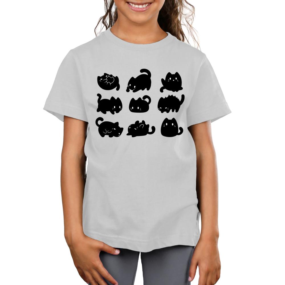 9 Spooky Kitties Kid's t-shirt model TeeTurtle silver t-shirt featuring 9 black kitties in different positions