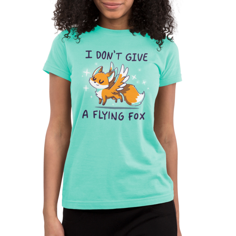 I Don't Give a Flying Fox Junior's t-shirt model TeeTurtle light turquoise t-shirt featuring a fox with wings