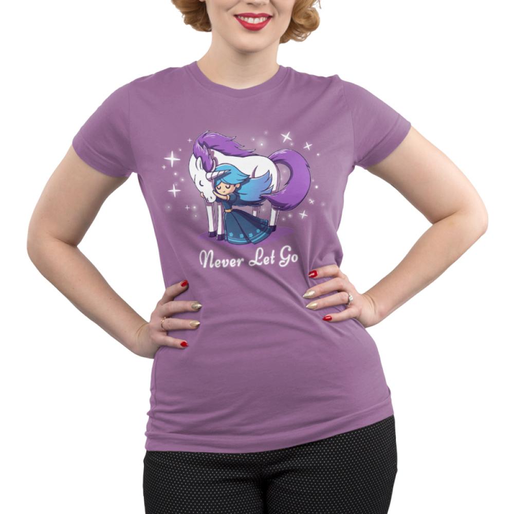 Never Let Go Junior's t-shirt model TeeTurtle purple t-shirt featuring a princess hugging a unicorn