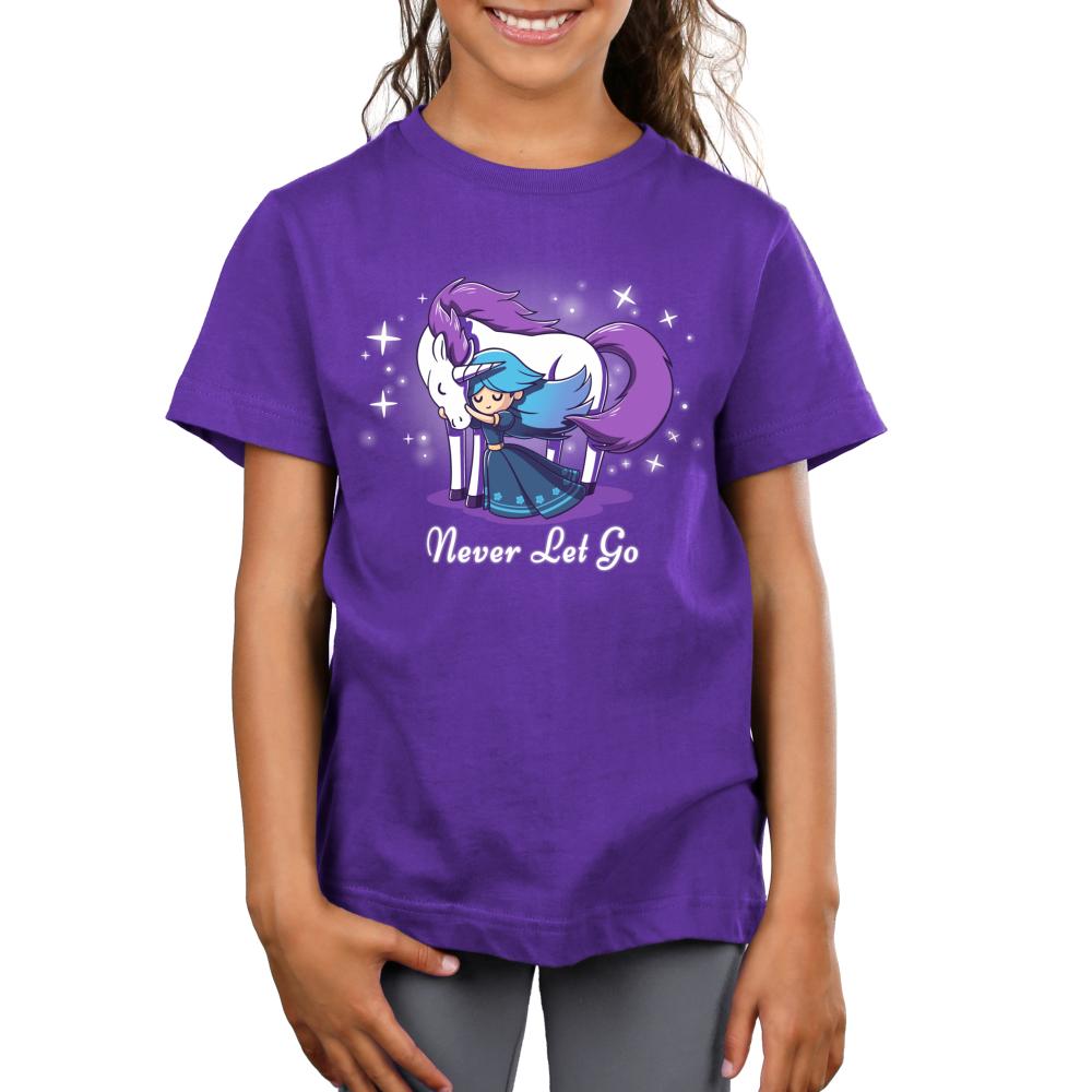 Never Let Go Kid's t-shirt model TeeTurtle purple t-shirt featuring a princess hugging a unicorn