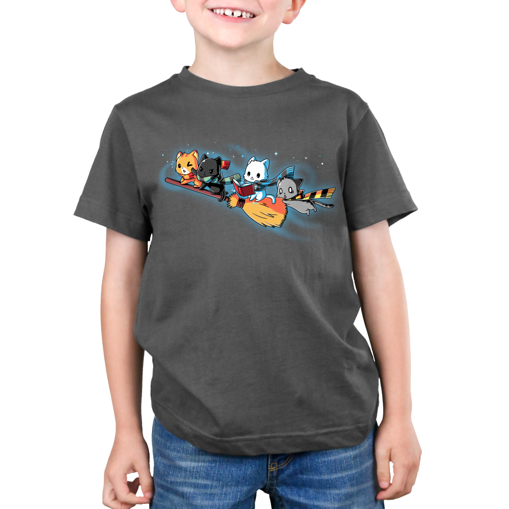 Flying House Cats Kid's t-shirt model TeeTurtle charcoal t-shirt featuring four cats flying on a broom stick
