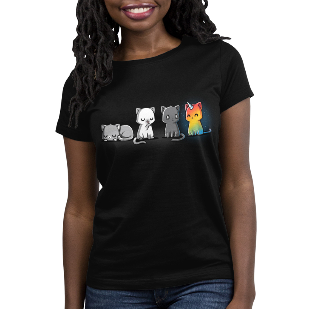 Meows & Magic Women's t-shirt model TeeTurtle black t-shirt featuring four cats - one laying down, one licking its paw, one looking scared, and one rainbow kittencorn