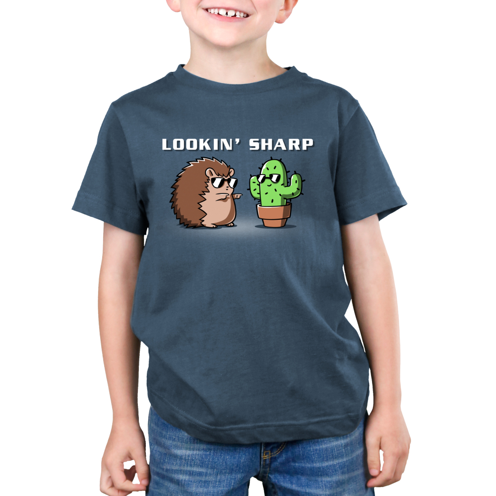 Lookin Sharp Kid's t-shirt model TeeTurtle indigo t-shirt featuring a hedgehog in sunglasses shooting finger guns at a cactus in sunglasses
