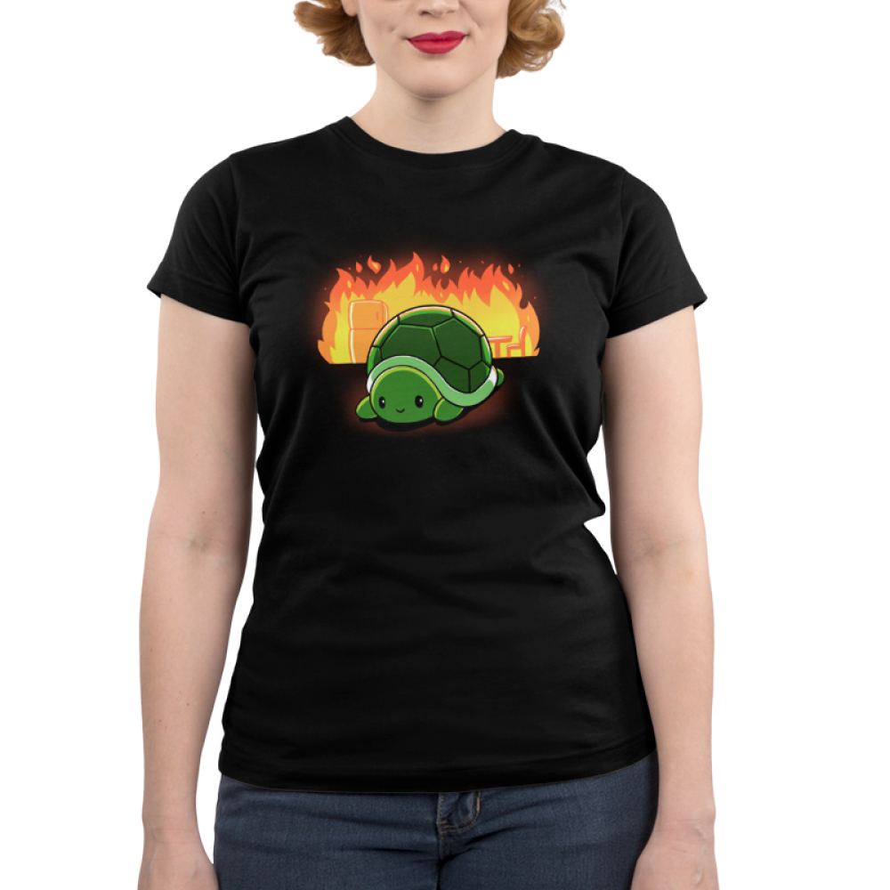 This is Fine Junior's t-shirt model TeeTurtle black t-shirt featuring a turtle with a chair and refrigerator on fire behind him