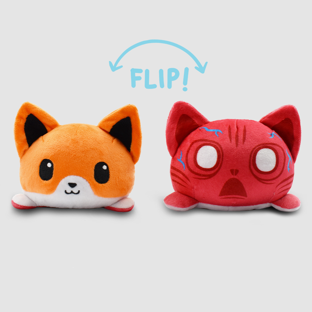 Reversible Scaredy Fox featuring an orange fox that when flipped inside out, its red and veiny insides can be seen