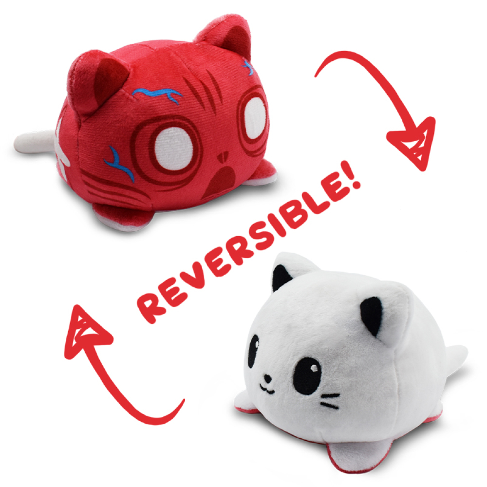 Reversible Scaredy Cat Mini featuring a white cat that when flipped inside out, its red and veiny insides can be seen