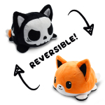 Reversible Spooky Fox Mini featuring an orange fox that when turned inside out, becomes a black and white fox in a skeleton costume