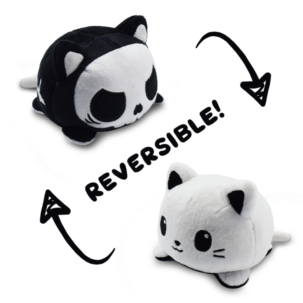 Reversible Spooky Cat Mini featuring a white cat that when turned inside out, becomes a black and white cat in a skeleton costume