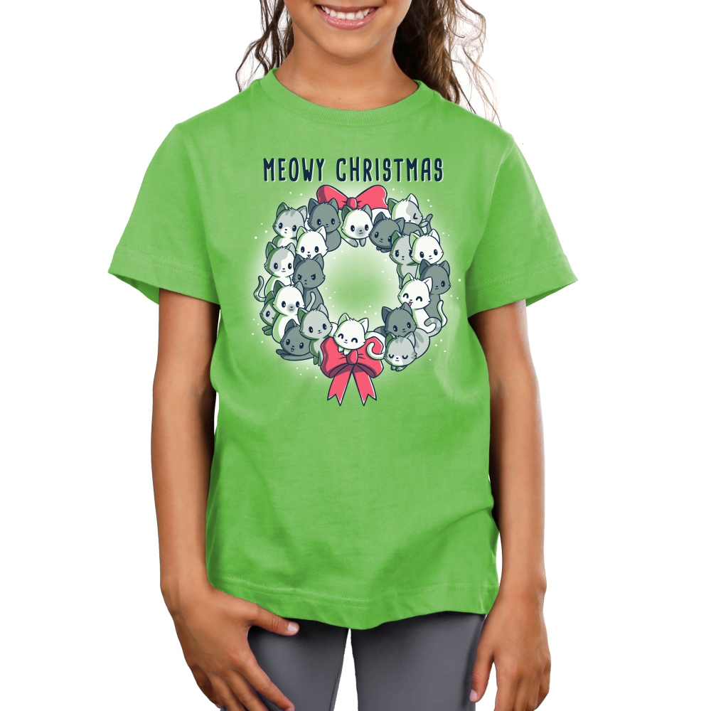 Meowy Christmas Wreath Kid's t-shirt model TeeTurtle apple green t-shirt featuring a wreath full of cats