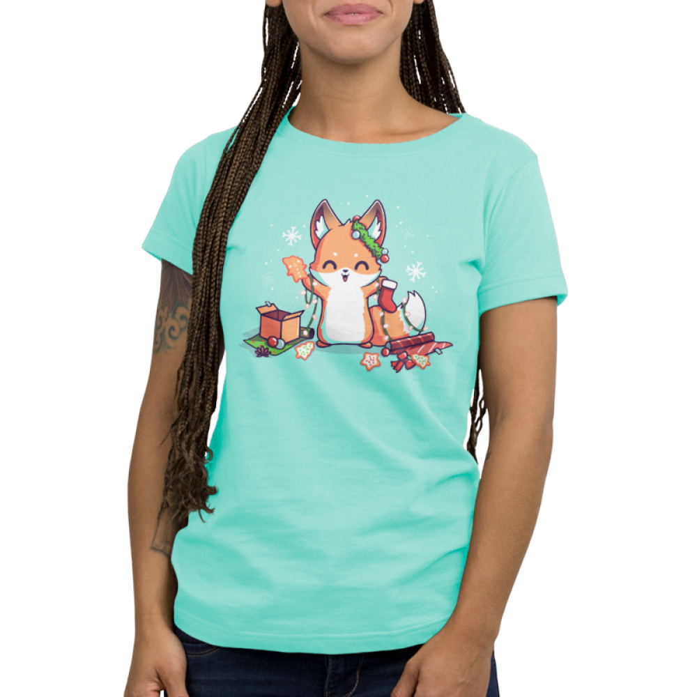 It's That Time of Year Women's t-shirt model TeeTurtle light turquoise t-shirt featuring a fox surround by holiday cookies, wrapping paper, ornaments, snowflakes, and holiday lights
