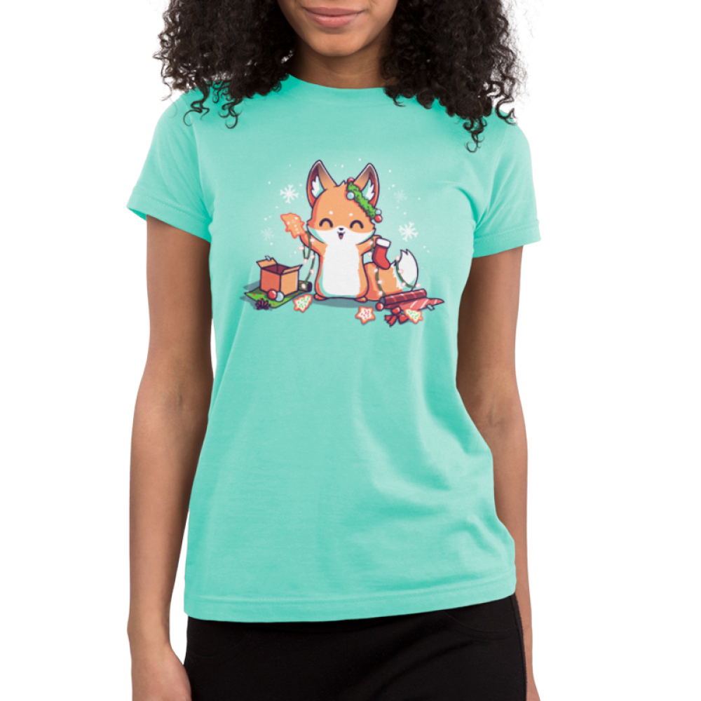 It's That Time of Year Junior's t-shirt model TeeTurtle light turquoise t-shirt featuring a fox surround by holiday cookies, wrapping paper, ornaments, snowflakes, and holiday lights