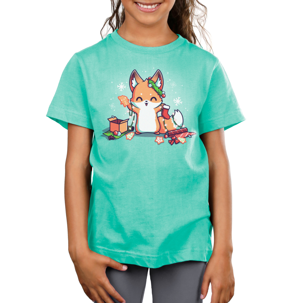 It's That Time of Year Kid's t-shirt model TeeTurtle light turquoise t-shirt featuring a fox surround by holiday cookies, wrapping paper, ornaments, snowflakes, and holiday lights
