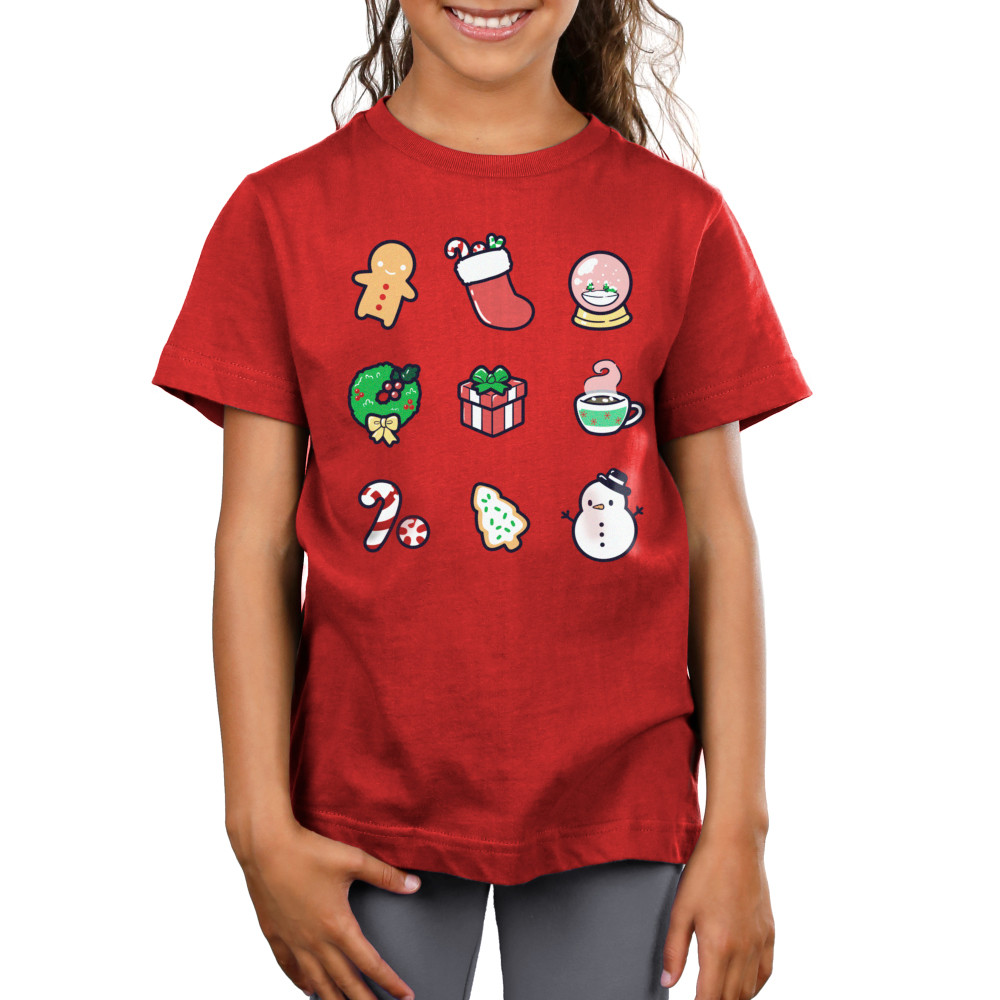 Why I Love Christmas Kid's t-shirt model TeeTurtle red t-shirt featuring a gingerbread man, stocking, snow globe, wreath, present, hot chocolate, candy cane, Christmas cookie, and snowman