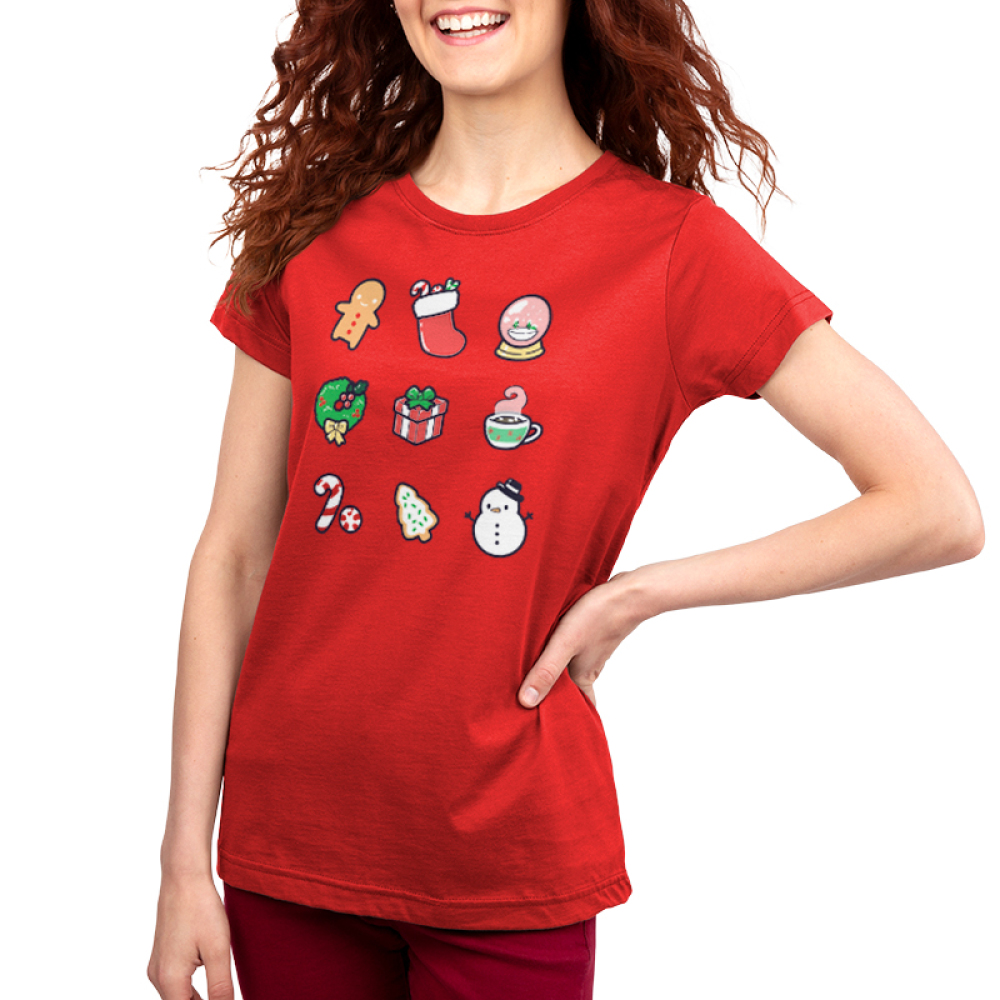 Why I Love Christmas Women's t-shirt model TeeTurtle red t-shirt featuring a gingerbread man, stocking, snow globe, wreath, present, hot chocolate, candy cane, Christmas cookie, and snowman
