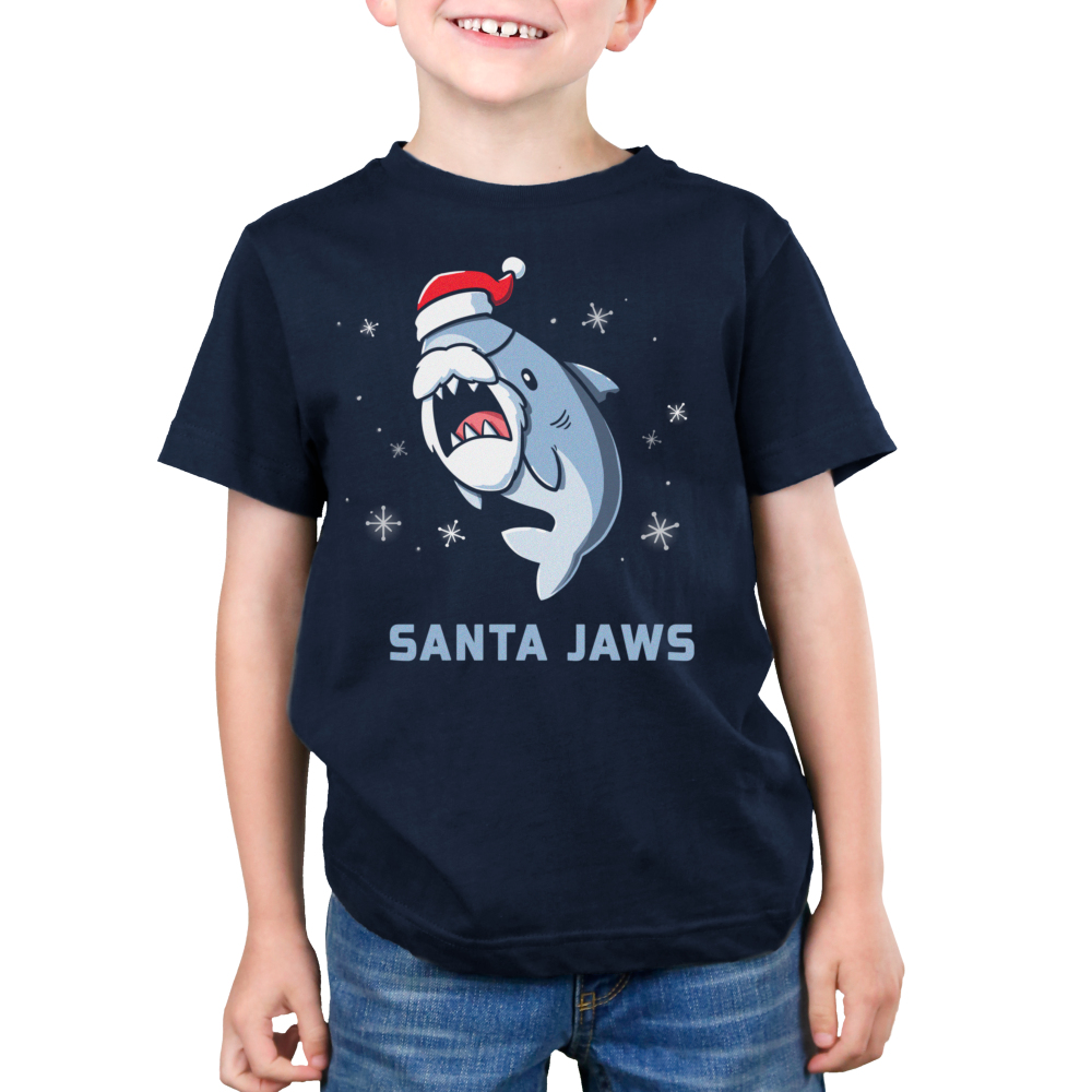 Santa Jaws Kid's t-shirt model TeeTurtle navy t-shirt featuring a shark in a santa hat and beard with snowflakes around him