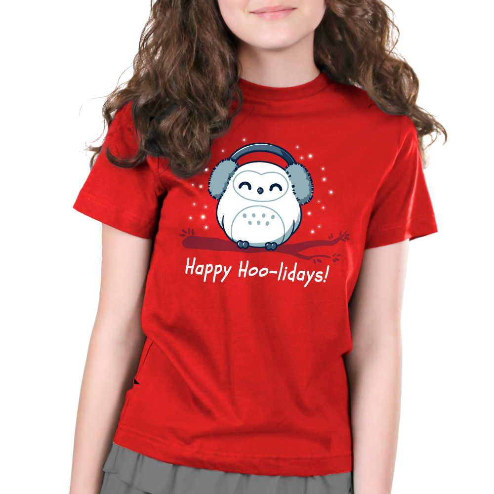 Happy Hoo-lidays Kid's t-shirt model TeeTurtle red t-shirt featuring an owl in ear muffs on a branch with snow around him