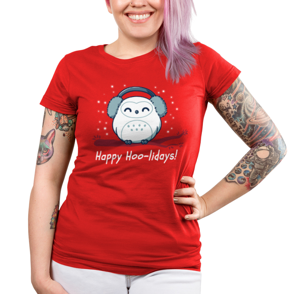 Happy Hoo-lidays Junior's t-shirt model TeeTurtle red t-shirt featuring an owl in ear muffs on a branch with snow around him