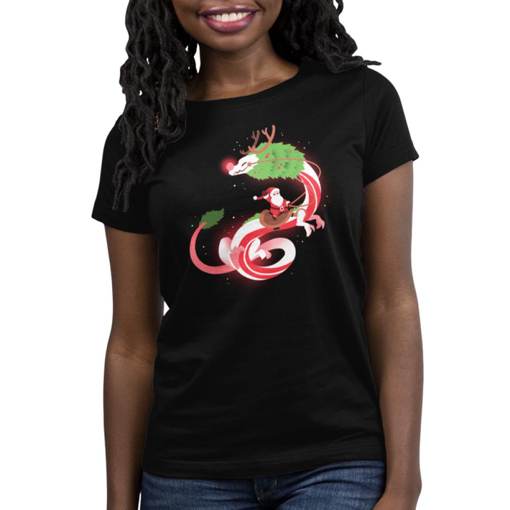 Christmas Dragon Women's t-shirt model TeeTurtle black t-shirt featuring Santa Claus riding a big dragon dressed as a reindeer