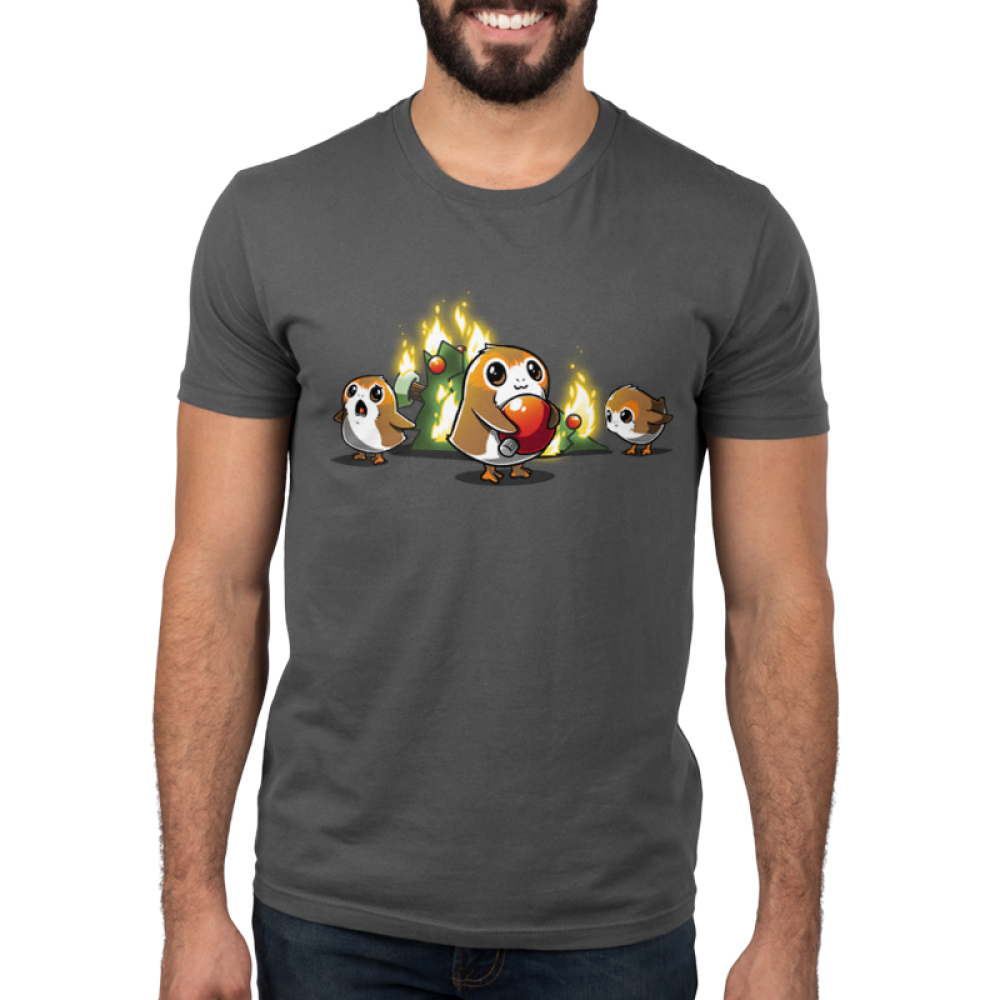 Porgs Ruin Christmas Men's t-shirt model officially licensed Star Wars charcoal t-shirt featuring three porgs with a christmas tree on fire behind them